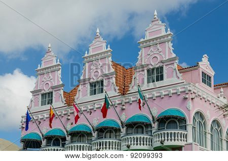 Flags And Green Awnings On Pink Stucco