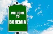 image of bohemia  - Green road sign with greeting message WELCOME TO BOHEMIA isolated over clear blue sky background with available copy space - JPG