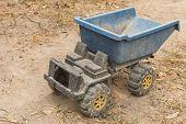 picture of dump  - Dump trucks plastic toy on the ground - JPG