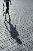 picture of poitiers  - Ballerina in blue jeans and pointe stands on tiptoe on a granite tile - JPG