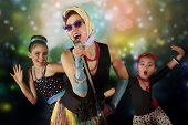 image of rockabilly  - Pinup and rockabilly woman with her daughters having fun posing with vintage microphone in 1950 - JPG