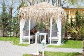 stock photo of pergola  - Image of a garden pergola on a sunny day with thatching - JPG