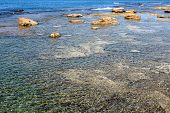 image of tide  - wild seascape with low tide and surfacing rocks - JPG