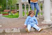 image of disobedient  - Naughty Girl 2 years old sitting on the ground - JPG