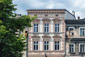 image of tenement  - Renovated ancient tenement next to dilapidated building in the Old Town Market Square in Bielsko - JPG