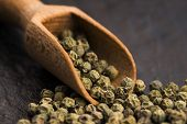 pic of peppercorns  - Green Peppercorns on a wooden background - JPG