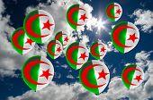 foto of algeria  - many ballons in colors of algeria flag flying on sky - JPG