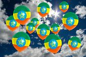image of ethiopia  - many ballons in colors of ethiopia flag flying on sky - JPG