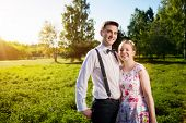 picture of fiance  - Young couple in love portrait in summer park - JPG