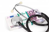 picture of stethoscope  - Stethoscope and money isolated on white background - JPG