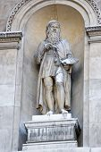 stock photo of burlington  - Stone Statue of the artist  Leonardo Da Vinci on the outside of Burlington House on Piccadilly - JPG