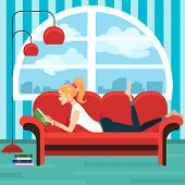 picture of sofa  - Beautiful young woman reading book on sofa - JPG