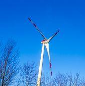 picture of generator  - wind generator in landscape under blue sky  - JPG