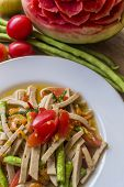 image of green papaya salad  - green papaya salad with pork on blue sky dish - JPG
