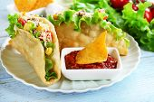 picture of tacos  - Tasty taco with tomato dip on plate on table close up - JPG
