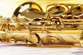 image of musical scale  - Shiny golden alto saxophone with detailed view of keys - JPG