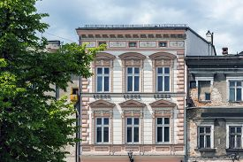 foto of tenement  - Renovated ancient tenement next to dilapidated building in the Old Town Market Square in Bielsko - JPG