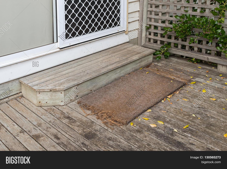 Old plain coir doormat placing image photo bigstock old plain coir doormat placing in front of the doorstep at back door during autumn kristyandbryce Images