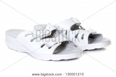 white sandals in front of white background
