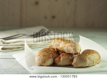 Fresh Tasty puffs on wooden table, horizontal view