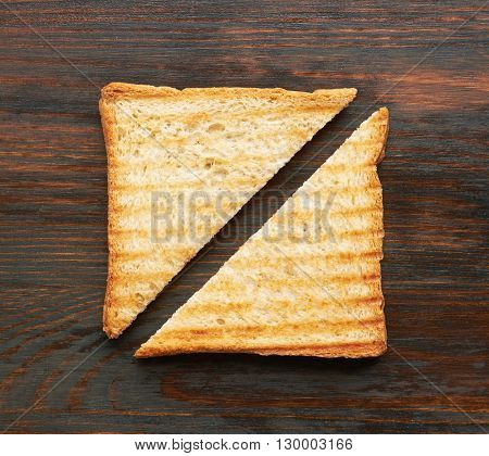 Toasts on wooden background, close-up