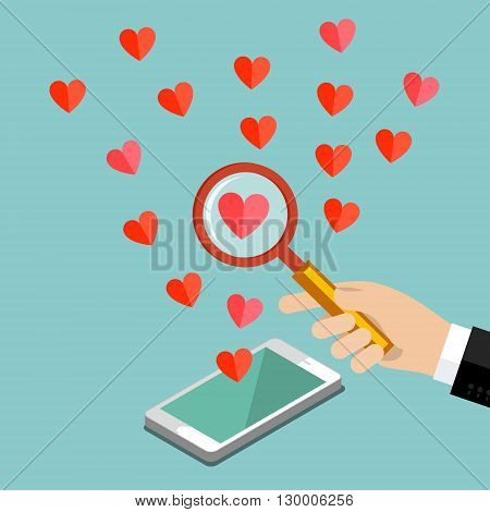 Concept of love or relationship. Hand with magnifying glass looks at heart.