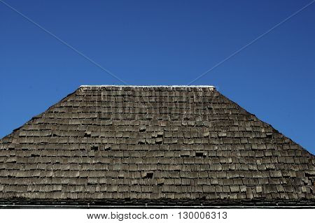 a picture of an exterior building wood shingle roof