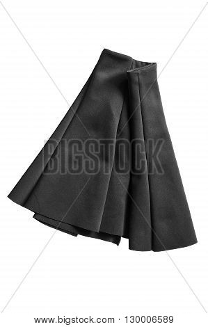 Black basics mini skirt folded on white background