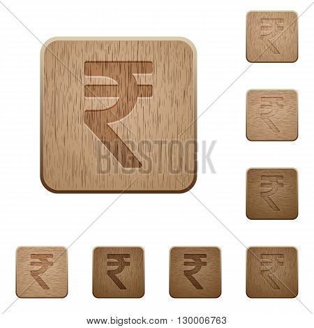 Set of carved wooden Indian rupee sign buttons in 8 variations.