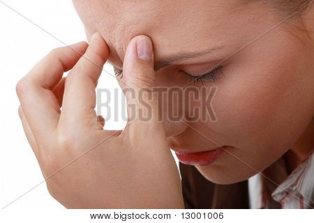 Woman with severe Migraine Headache holding hands to head