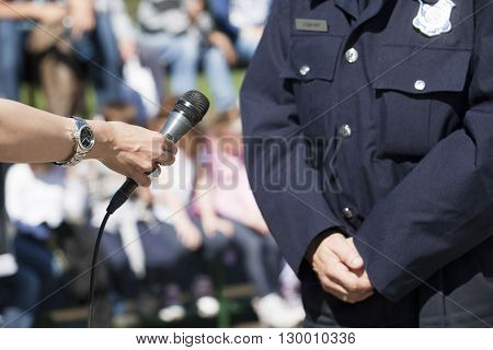 Journalist is making an interview with a policeman