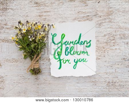 Wild viola flowers bouquet tied with jute rope and watercolor lettering