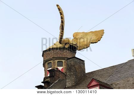 Cologne, Germany - May 16: This is tower gable Cologne City Museum decorated with a winged vehicle May 16, 2013 in Cologne, Germany.