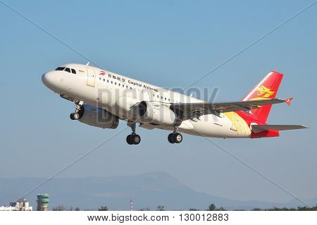 Simferopol Ukraine - September 12 2010: Capital Airlines Airbus A319 is taking off from the airport with mountains on the background