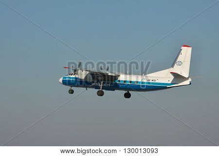 Simferopol Ukraine - September 12 2010: Antonov An-24 turboprop passenger plane is taking off from the airport in the evening