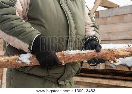 Carpenter working at sawmill