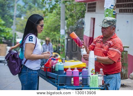 PANCHIMALCO EL SALVADOR - MAY 08 : A shaved Ice stand at the Flower & Palm Festival in Panchimalco El Salvador on May 08 2016