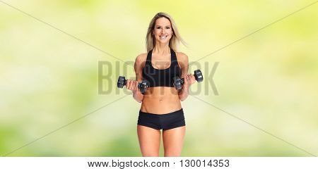Beautiful fitness girl with dumbbells.