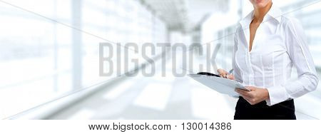 Business woman hands with a clipboard.