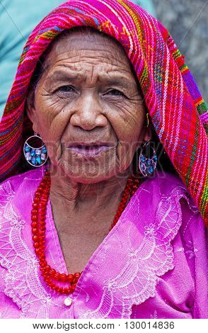 PANCHIMALCO EL SALVADOR - MAY 08 : Portrait of an old Salvadoran woman during the Flower & Palm Festival in Panchimalco El Salvador on May 08 2016