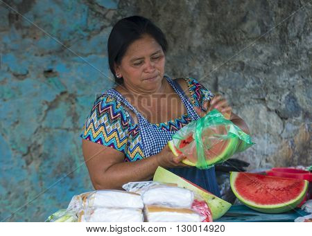 PANCHIMALCO EL SALVADOR - MAY 08 : A Salvadoran woman sells fruits during the Flower & Palm Festival in Panchimalco El Salvador on May 08 2016