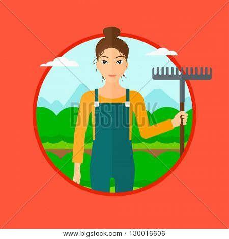 Farmer with rake at cabbage field.