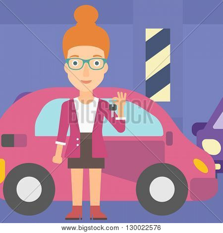 Woman holding keys from new car.