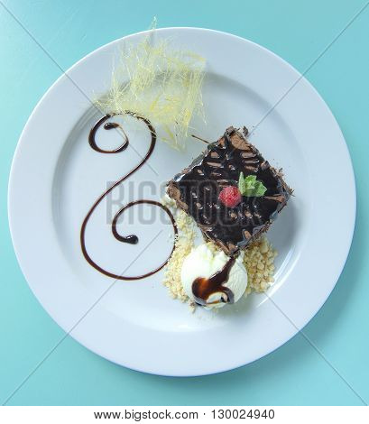 tasty double chocholate brownie with icecream plating