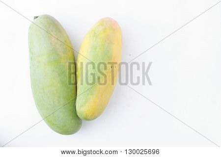 Fresh organic mango on isolated white background
