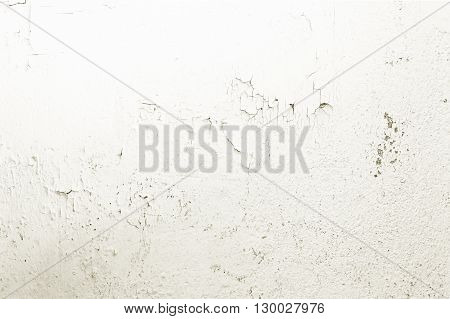 the white grunge wall with cracks background