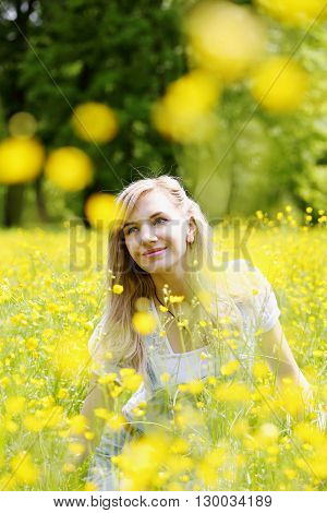 Women enjoying nature in meadow. Girl on the meadow with flowers buttercups