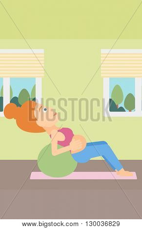 Pregnant woman on gymnastic ball.