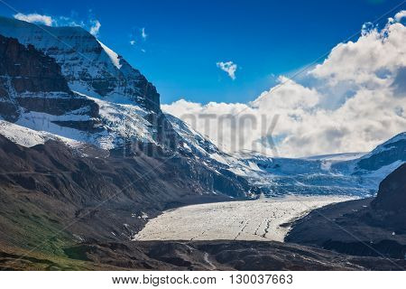 The surface of glacier is covered with huge cracks. Melting Columbia Icefield in Banff National Park, Canada
