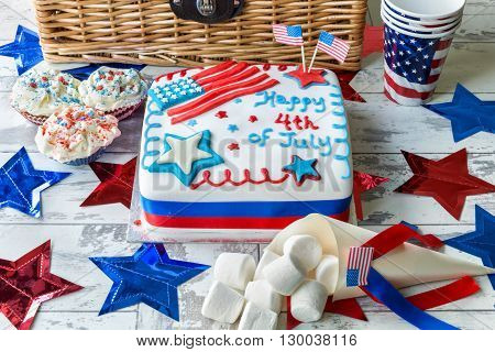 Happy 4th of July cake with hamper, cupcakes and marshmallows